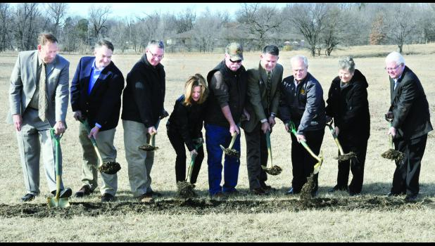 A groundbreaking for Homestead Affordable Housing's new Prairie View Senior Residences was held Monday in Holton near the town's soccer fields. Those assisting with the groundbreaking include (from left) Fred Bentley of the KHRC, Brad Reiff, HAH board member; Barry McMurphy of the KHRC, Congresswoman Lynn Jenkins, Holton Mayor Bob Dieckmann, Todd Heitschmidt of Central National Bank, Larry Krier of LK Architecture, 61st District Rep. Becky Hutchins and AJ Caputo of Accel Construction LLC.