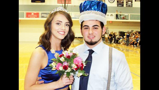 Holton High School seniors Sydney McRae (left) and Torin Kaboudan were named queen and king of the Wildcats' winter courtwarming games against Sabetha on Friday evening. The 'Cats split the evening's games against the Blue Jays, with the boys varsity team getting a home court win while the girls took a loss. (Photo by Brian Sanders)