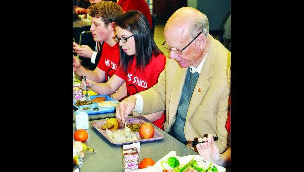 U.S. Senator Pat Roberts had lunch at Holton High School, his alma mater, on Thursday and discussed the federal requirements for school lunches with a handful of students. Pictured with Roberts are Tel Wittmer (left) and Maddie Reith (center). Roberts serves as the chair of the Senate Committee on Agriculture, Nutrition and Forestry, and he said he hopes to visit 10 Kansas schools this year before the federal food lunch program is reauthorized.