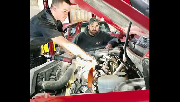 Ireland Custom Exhaust of Holton is one of the many essential local businesses in the community. The photo above shows Cody Ireland and Justin Henery looking over a vehicle's engine at the shop recently. A good portion of ICE's business is agriculture-related, according to owners Barry and Kelle Ireland. Call ICE at 785-364-2871 for more information about how the business can serve you when you need them. (Photo by David Powls)