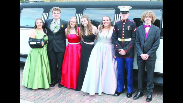 Holton High School students and their dates donned formal wear and arrived at HHS in a variety of vehicles, ranging from stretch limousines to all-terrain vehicles, for this year's prom, held Saturday evening at the school. Shown from left to right are Ally Beard, Brady Pound, Deanna Browning, Madison Gosney, Alexis Hennis, Johnathan Holmes and Jaxon Snavely. (Photo by Brian Sanders)