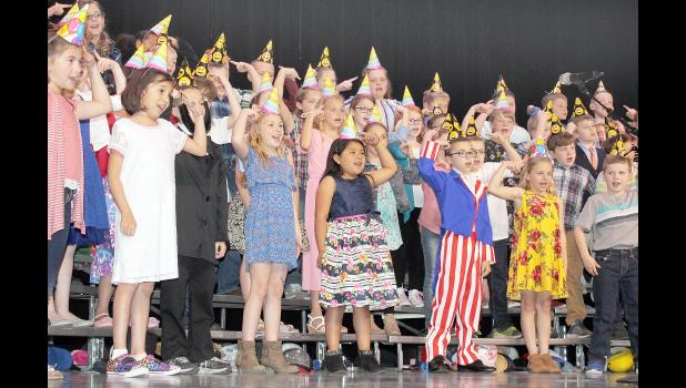 "Holton Elementary School's third-graders donned party hats — and other kinds of hats — for their spring concert last Tuesday in the Holton High School auditorium. The headgear was key to the musical presented by the class, titled ""Hats! A Musical That Celebrates What's Underneath."" (Photo by Brian Sanders)"