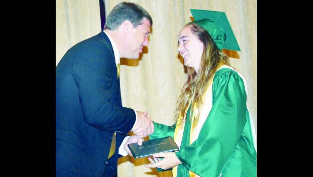 Jackson Heights USD 335 Board of Education President David Allen (left) presented JHHS senior Meghann Eisermann (right) and 24 other graduating Cobras with their diplomas during commencement exercises on Sunday afternoon.