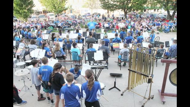 "The ""Second Annual Pops Concert On The Square"" drew hundreds to the east side of the Jackson Counnty Courtyard on Thursday evening for performances by about 200 band students in the Holton school district. Here, Jayme Malsom is seen conducting the sixth-grade band. (Photo by Brian Sanders)"
