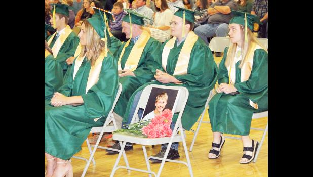 Jackson Heights High School student Garrett Klahr, who died in a 2018 traffic accident, was honored by his classmates (shown from left to right, Dylan Thompson, Amaya Marlatt, Jason White, Garrett Will and Kati Woltje) during JHHS commencement exercises on Sunday. Nineteen JHHS seniors received their diplomas during commencement exercises on May 16. (Photo by Brian Sanders)