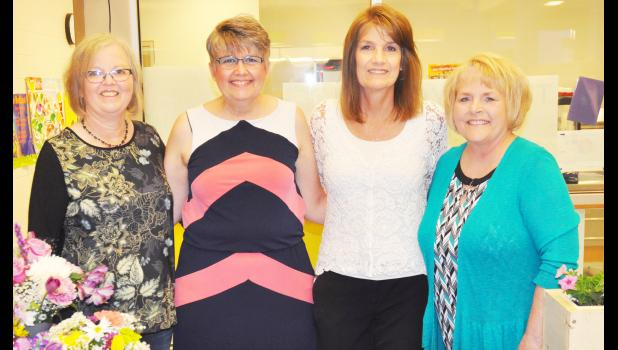 A retirement celebration was held at Holton Elementary School last Thursday afternoon for the four retiring  staff members shown above (from left) Nancy Lundin, Mary Porter, Sheila Day and Robin Fernkopf. The last day of classes for Holton students is Wednesday. (Photo by Ali Holcomb)