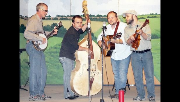 Thursday's Prairie Lake Pickin' Party saw a family reunion of sorts with the Faris Family, the Jefferson County-based bluegrass group that performed at the first Pickin' Party nearly a quarter of a century ago. (Photo by Brian Sanders)