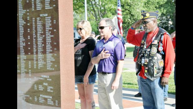 "As part of the Kansas Legacy Run, American Legion Riders from across Kansas stopped on Friday morning at the Purple Heart monument at Holton's Linscott Park to pay tribute to the late Pfc. Cody Baker and other fallen soldiers from the area. In the photo above, Baker's parents, Candy (left) and Mike (center) McManigal are shown during the ceremony along with Theardies ""T-Man"" Fisher of Wichita. About 40 motorcycle riders participated in the run that went through Holton. (Photo by Ali Holcomb)"