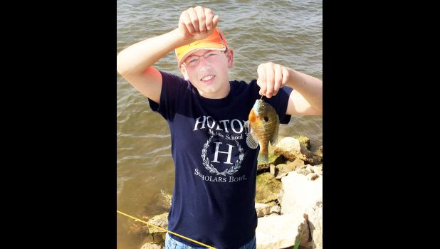 Seth Peterson of Holton snagged this seven-inch bluegill at the event.