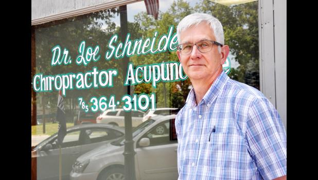Holton chiropractor Joe Schneider's last day on the job will be Friday after serving the Holton community for nearly 32 years. (Photo by Ali Holcomb)