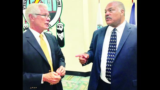Carl Brewer, former mayor of Wichita and a Democratic Party candidate for governor, shown above at right, visited with Barry Grissom, the former U.S. attorney who served as moderator for Sunday afternoon's Democratic candidate forum held at the Prairie Band Potawatomi's old bingo hall.