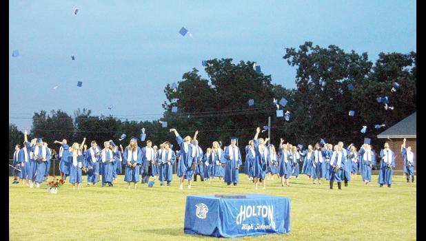 Holton High School's graduating class of 2020 participated in the traditional cap toss at the end of their commencement ceremony, held Friday, July 10 at the HHS football field. (Photo by Brian Sanders)