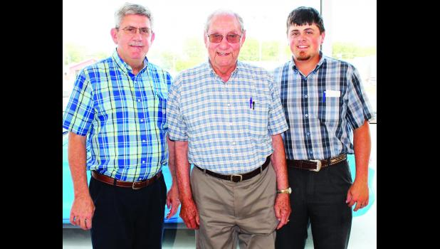 Ray Foster (center) has been named grand marshal of the Jackson County Fair Parade on Wednesday, Aug. 2. Shown with Foster are his son, Scott Foster (left) and his grandson, Jordan Foster.