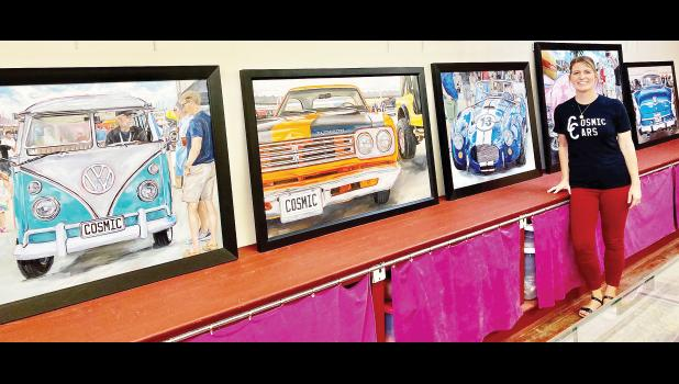 """Holton's Town Square was a hub of activity on Friday night, where the Jackson County Art Walk was being held. In the photo above, artist April Spicer showed off some of her """"Cosmic Cars"""" paintings at the Jackson County Museum, which will feature Spicer's art from 10 a.m. to 2 p.m. Saturday, Aug. 20. (Photo by David Powls)"""