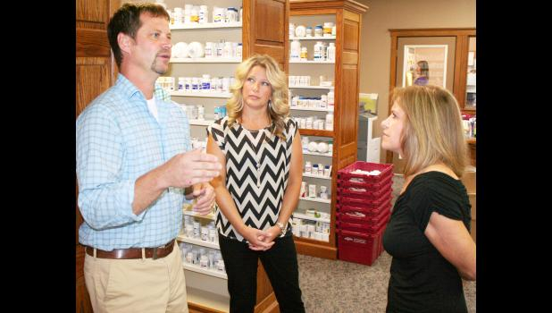 Congresswoman and Holton native Lynn Jenkins (right) stopped on Thursday at Holton's Medical Pharmacy to visit with pharmacist Joe Gilliland (left) and his wife, Carrie, and discuss health care concerns during Jenkins' two-day tour of hospitals and health care centers in eastern Kansas. (Photo by Brian Sanders)
