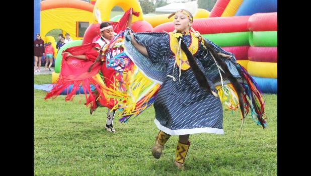 """Panno Wahwassuck (at right) and Kiwe Miller, members of the Royal Valley Singers and Dancers, took part in an """"intertribal dance"""" Saturday morning in Hoyt City Park as part of the annual Pride of Hoyt Days festival. The display of native dance was a new feature in the 33rd-annual festival. (Photo by Brian Sanders)"""