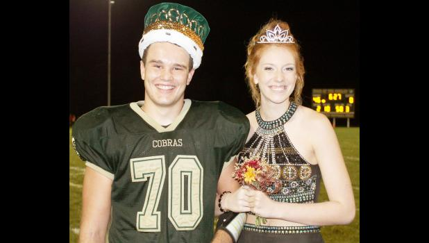 Jackson Heights High School seniors Kaleb Keehn (left) and Hannah Williams were named homecoming king and queen on Friday night, at halftime of the Cobras' 46-7 dismantling of the Oskaloosa High School Bears. (Photo by Brian Sanders)