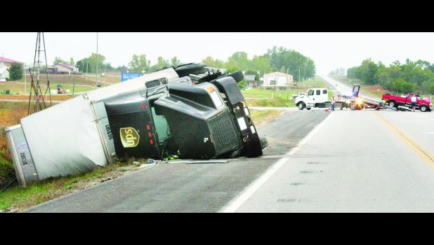 A UPS truck and trailers rolled into the ditch following a two-vehicle accident this morning at the intersection of U.S. Highway 75 and Columbine Drive near Holton Community Hospital. The truck's driver, Daryl Compton of Topeka, as well as the other vehicle's driver, Paul Krogman of Holton, were injured in the accident, and U.S. 75 north of Holton was shut down for more than an hour as a result of the accident.