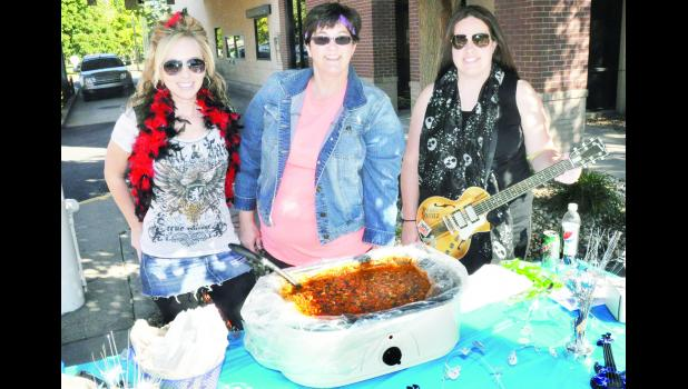 "On Saturday, these ""rockstars"" from Holton National Bank had the best tasting chili, according to the four judges at the annual Chili Cook-Off. Those pictured are (from left) Ashley Gray Cureton, Jenny Reed and Vanessa Ogden. The women donated their $50 prize to the Banner Creek Science Center & Observatory."