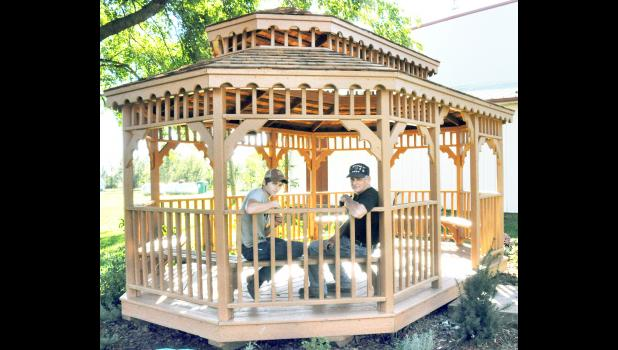 Justin Jordan (left), a junior at Rossville High School, and his grandfather, Cecil Spetter of Mayetta, recently reroofed and restored the gazebo in downtown Mayetta. The restorations were completed as an Eagle Scout project for Justin, who is a member of Boy Scout Troop 7. (Photo by Ali Holcomb)