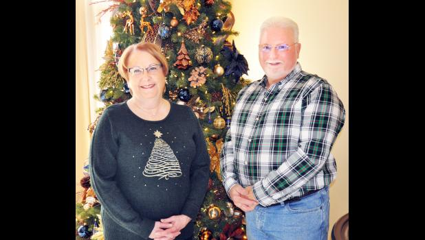 Rhonda (left) and Randy Magnison of Holton will be opening their home on Saturday, Dec. 7 as one of five families participating in this year's Holton/Jackson County Chamber of Commerce Christmas Homes Tour, it was reported. (Photo by Ali Holcomb)