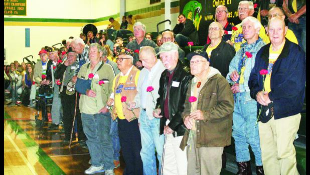 Veterans in attendance at Jackson Heights' Veterans Day assembly on Tuesday morning received red carnations from Heights students as thanks for their military service.