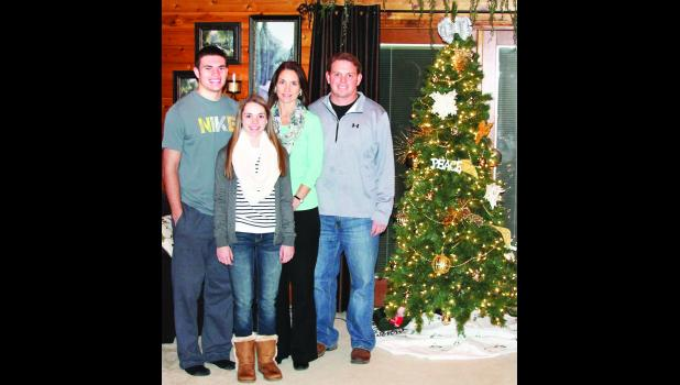 "The Barta family, which includes (from left) Mason, Tabor, Tonya and Brooks, are opening up their home on 214th Road next Saturday as one of five stops on the ""I'll Be Home for Christmas"" homes tour."