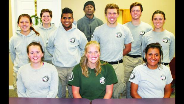 Members of the third AmeriCorps team to visit Jackson County through the auspices of Homestead Affordable Housing include, front row, from left: Rebecca Huffman, team leader Ashley White and Suzie DeLoera. Middle row, from left: Nicole Rockwell, Jahan Shepardson, Lukas Kelly and Brynn Furnace. Back row: Emma Hodgson, Dre Gadson and Sam Rutz. Not pictured: Sarah Conley.
