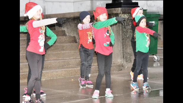 "Studio 1 Dance Center students who performed ""All I Want For Christmas Is You"" during Saturday's ""Small Town Christmas"" celebration in Holton included (from left) Payton Crawford, Khyia Jenkins, Julie Wellman, Keirya Taylor and Samantha LaRoche (back right). (Photo by Ali Holcomb)"