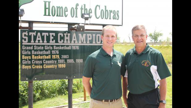 Lyle Alley (shown above, at right) may have stepped down as the head cross country and track coach for JHHS at the end of this past season, but a familiar name will be taking over as his son, Brad (left), will fill those same roles starting in the 2015-2016 school year.