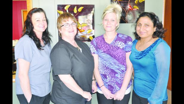 Dr. Saroj Gupta (right) and her husband, Shekhar, purchased Ann's Home Health in Holton in January. Dr. Gupta said the business continues to provide the same services, and she does not plan to change the name. Gupta is pictured with employees (from left) Stephanie Page, Ronda Sanders and Randee Hopeck.