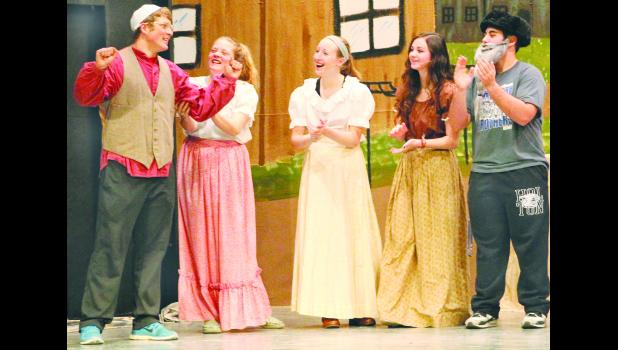 """Fiddler on the Roof,"" one of the most popular Broadway musicals, is being staged this weekend by Holton High School students. In the scene above, Motel, a poor tailor played by Tel Wittmer, rejoiced over the fact that he could afford a sewing machine for his business. Additional cast members, who were also excited for Motel, included from left Emma Wittmer, Anne Bowser, Mary Gorden and Torin Kaboudan."