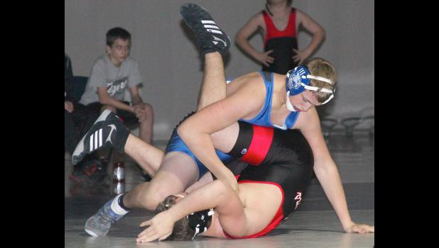 Holton's Kyler Tannahill (shown above, top) gets position on his opponent to set up a pin in one of the matches in the Wildcats' dual against Jeff West. Tannahill was one of several young wrestlers to turn in strong performances in the double dual at HHS.