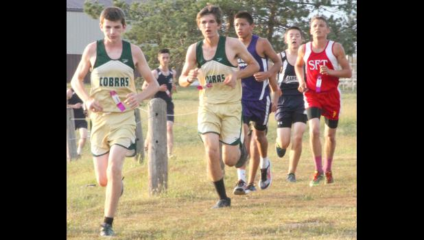 From left to right, Jackson Heights' Xavier Fritz, Dalton Chartier and Royal Valley's Ninahii Frisby lead a pack of runners at a recent meet in Hoyt. All three turned in solid performances again at Horton last Thursday, helping their teams to fourth and fifth-place finishes respectively.