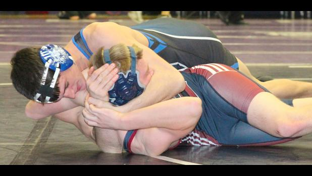 Holton senior Lucas Lovvorn (shown above, on top) works on pinning his opponent in regional competition last weekend. After a dominant showing in Baldwin, Lovvorn is eyeing a second straight individual state title in Salina this weekend.