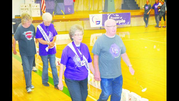 The 23rd annual Jackson County Relay For Life was held Saturday evening at the Jackson Heights High School gymnasium. In the top photo, Ilah Rose (left) and Dale Askren of Holton are shown walking around the gymnasium followed by Leota Wilkerson (left) and Deloris Beam, who are first cousins from Circleville.