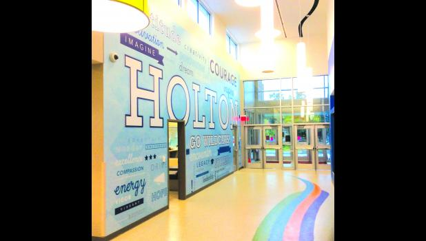 During Sunday's open house for the new Holton Elementary School, members of the public will be able to tour the building, which includes several murals like the one shown above. This mural can be seen to the right as soon as students and staff enter the building each day. The colorful paths on the floor lead to the different grade-level classrooms in the building.