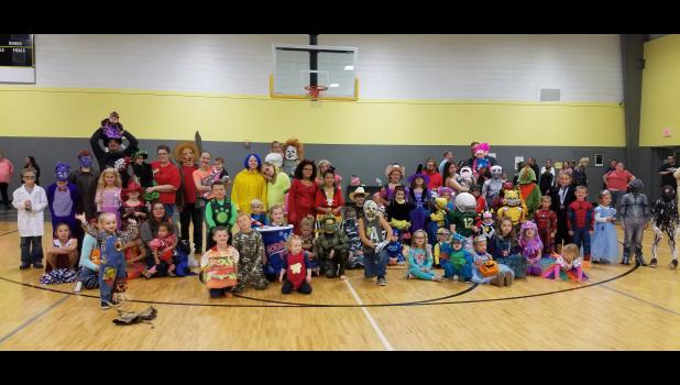 KNOW ANY OF THESE PEOPLE? They are hard to recognize in the colorful costumers they wore to the Halloween Party at the Netawaka Family & Fitness Center. Over 160 parents and children were on hand for the fun event.