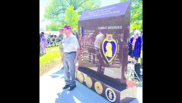 After the new Purple Heart Monument was unveiled here Saturday, some local recipients of the medal – like Robert Stapel of the Meriden area, had their photos taken beside the monument.