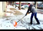 Jhett's Pizza owner Luke Deeter spent part of this morning shoveling what was left of Satur¬day night's snow from the sidewalk in front of his pizzeria on Holton's Town Square. The week¬end snowstorm brought little more than an inch of precipitation to the Holton area along with bittterly cold temperatures, the latter of which is expected to stick around for the rest of this week.