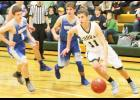 Jackson Heights senior Wyatt Olberding drives to the basket in a recent game against Horton.
