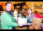 "Kansas Gov. Sam Brownback (left) presented Candi Marr, owner of Heart To Home in Holton, with a certificate honoring the store's ""success and positive contributions... to its community and the State of Kansas"" during the governor's Friday morning visit to Holton. Brownback was in town that morning to talk about small business, but he also heard concerns from area citizens about cuts in education funding."