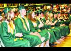 Jackson Heights High School seniors (from left) Aidan Allen, Austin Amon, Kay Andrews, Caleb Baker, Jessica Blum, Emily Bowhay, Heaven Bratcher and Roan Bruggeman listened intently to the words of their classmates and co-valedictorians Will Patterson and Jessica Keehn during Sunday's commencement ceremony in the JHHS gym. (Photo by Ali Holcomb)