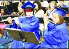 Holton High School seniors Elizabeth Mandala (left) and Chelsea Klahr played their flutes with the HHS concert band before they and 78 other Holton seniors graduated during Saturday's commencement exercises in the HHS gym. (Photo by David Powls)