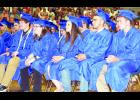 From left, Holton High School seniors Josh Bjelland, Madison Beightel, Samantha Beauchamp, Javier Batista-Alvarez and Mason Barta listened to classmate Alexandria Bontrager give her graduation speech during Saturday's commencement exercises in the HHS main gymnasium.