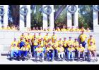 The group of veterans and guardians who participated in last week's Honor Flight through Jackson Heights posed for a group photo in front of the World War II Memorial in Washington, D.C. A total of 29 veterans and 19 student guardians took part in the day-long event.