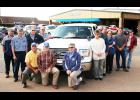The staff at Foster Ford-Mercury in Holton includes front row, from left, Lonnie Coder, Jordan Foster and Scott Foster; back row, from left, Devin White, Jeremy Ingels, Leroy Krogmann, Bill Newquist, Jeannie Arnold, Ray Foster, Rob Meyer, Tracey Shumaker, Justin Keithline and Jeremy Banaka. The award-winning Ford dealership has been open in Holton since July 1985. (Photo by Brian Sanders)