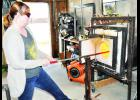 April Lemon has opened a glassblowing studio and art gallery on the east side of the Holton Square. The shop, More Than Lemons, offers a hands-on experience with glassblowing, which Lemon is demonstrating.