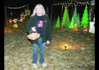 Debbie Calhoun shows off a handful of the colorful and bright Christmas light displays at her home near Larkinburg. The displays stretch for one-eighth of a mile and comprise more than 50 individual displays with about 26,000 lights, she said.