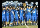 The Holton football team (shown above) hoists its regional trophy in the air after picking up a 35-12 victory over Osawatomie last Friday.